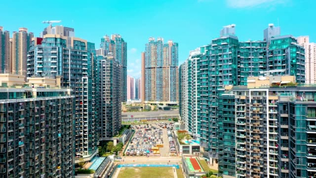 vídeos de stock e filmes b-roll de drone view of residential building in the tseung kwan o. hong kong - hong kong