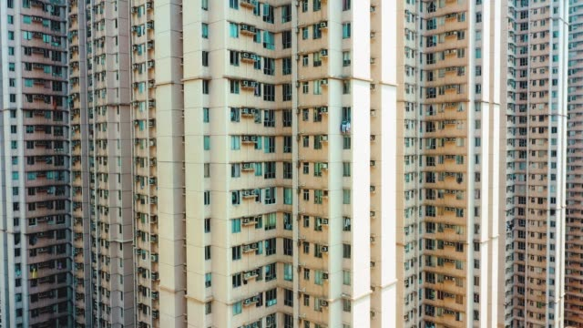 drone view of residential building in the tseung kwan o. hong kong - population explosion stock videos & royalty-free footage