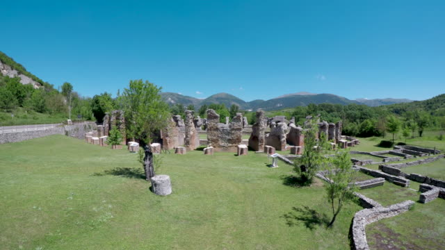 a drone view of roman amphitheatre in amiternum near l'aquila on may 30 2017 amiternum a traditional settlement of the sabines is an ancient sabine... - romans stock videos and b-roll footage