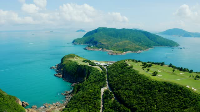 drone view of sai kung, hong kong - green golf course stock videos & royalty-free footage