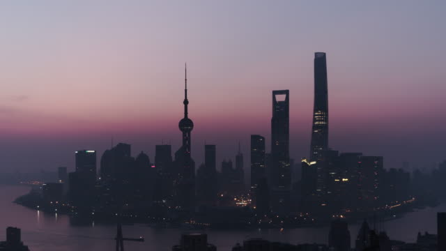 t/l pan drone view of shanghai skyline at dawn, from night to day / shanghai, china - dawn to day stock videos & royalty-free footage