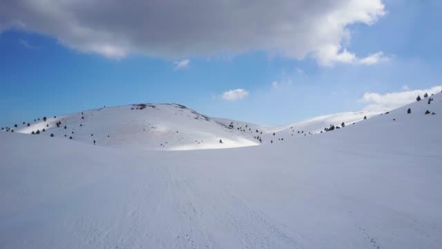 drone view of snowcapped mountains - カタルーニャ州点の映像素材/bロール