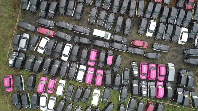 drone view of taxis stored in epping forest field amid covid-19 lockdown. black cabs stored in epping forest field after coronavirus lockdown forces... - taxi stock videos & royalty-free footage