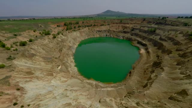 a drone view of the abandoned copper mine located almost in the village of tsar asen at an elevation of about 300 m above sea levelel some 100 kms... - copper mine stock videos and b-roll footage