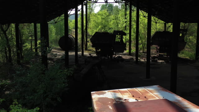 stockvideo's en b-roll-footage met a drone view of the agricultural transport station in the abandoned village of zymovysche near chernobyl on june 17 2019 the chernobyl disaster was a... - kernramp van tsjernobyl