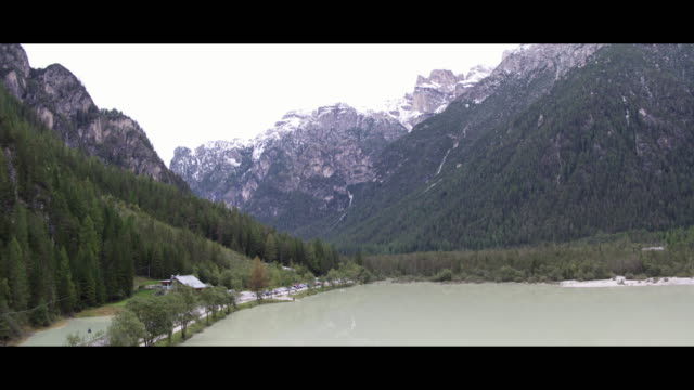 lago di landro german dürrensee lake in the dolomites in south tyrol italy on september 13 2017 the lake landro is part of the tre cime nature park... - lago stock videos & royalty-free footage