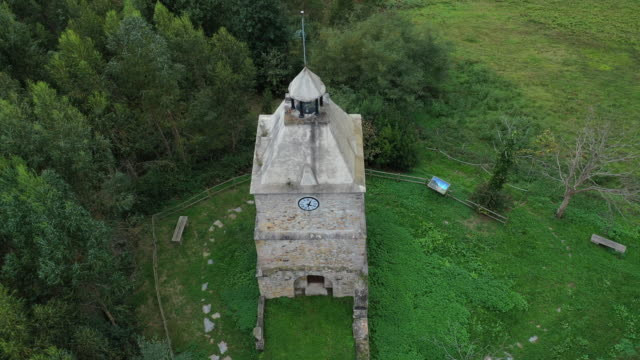 drone view of torre del reloj, limpias, montaña oriental costera, the way of saint james, cantabrian sea, cantabria, spain, europe - reloj stock videos & royalty-free footage