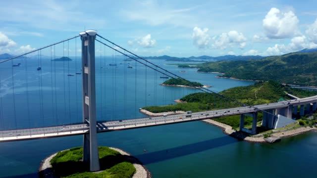 vídeos de stock e filmes b-roll de drone view of tsing ma bridge, hong kong - cidade inteligente