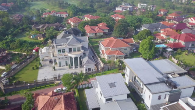 drone view of upscale houses - kuala lumpur stock videos & royalty-free footage