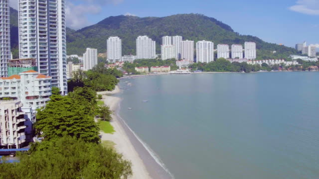 drone view of urban cityscape beside sea - malaysia stock videos & royalty-free footage