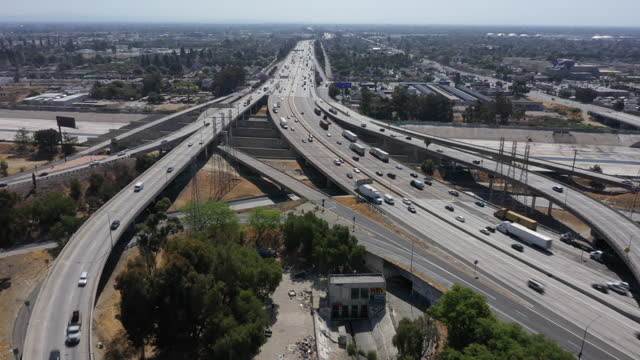 drone view of vehicles on the california sr 91 and interstate 710 freeway interchange in long beach ahead of memorial day weekend, ca, u.s, on... - long beach california stock videos & royalty-free footage