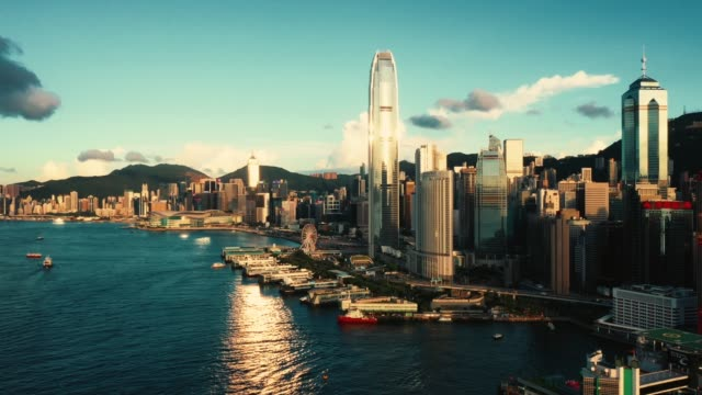 drone view of victoria harbour, hong kong - victoria harbour hong kong stock videos & royalty-free footage