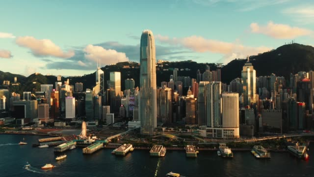 drone view of victoria harbour, hong kong - hong kong stock videos & royalty-free footage