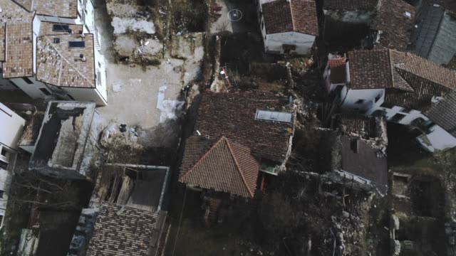 a drone view of village of villa sant'angelo on march 6 2019 about ten years on from the april 6 2009 earthquake that struck the abruzzo region of... - terremoto video stock e b–roll