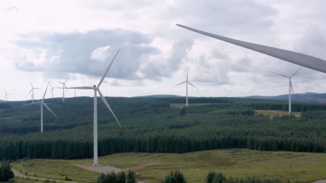 drone view of wind farm in brecon beacons - wales stock videos & royalty-free footage