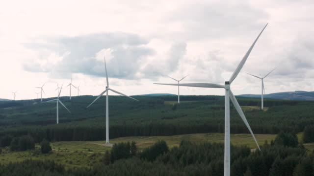 drone view of wind farm in brecon beacons - rural scene stock videos & royalty-free footage