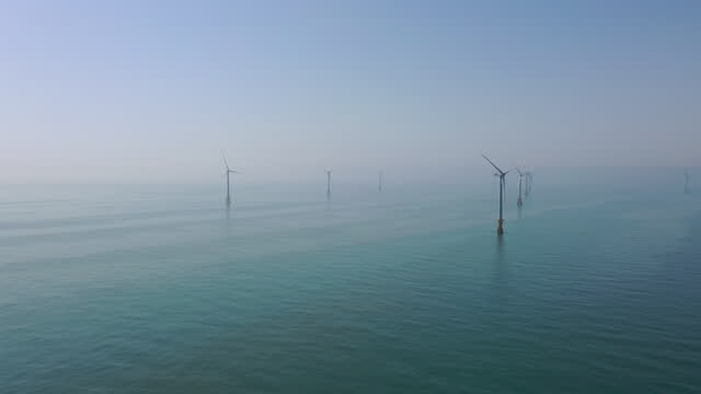 drone view of wind turbines at southwest offshore wind farm in south west sea, operated by korea offshore wind power corp., will be expanded to 2.46... - large group of objects stock videos & royalty-free footage