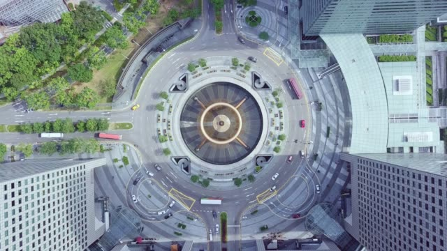 drone view over fountain of wealth of the singapore landmark financial business district with skyscraper. singapore downtown - big wheel stock videos & royalty-free footage