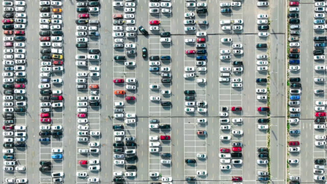 t/l pan drone view over outdoor parking lots - car park stock videos & royalty-free footage
