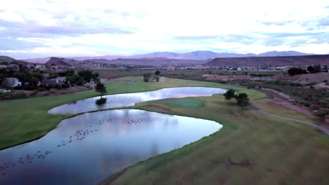 drone view sunrise over a beautiful golf course - green golf course stock videos & royalty-free footage