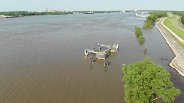 a drone views a big ship slip on the mississippi river in chalmette louisiana - nightdress stock videos & royalty-free footage