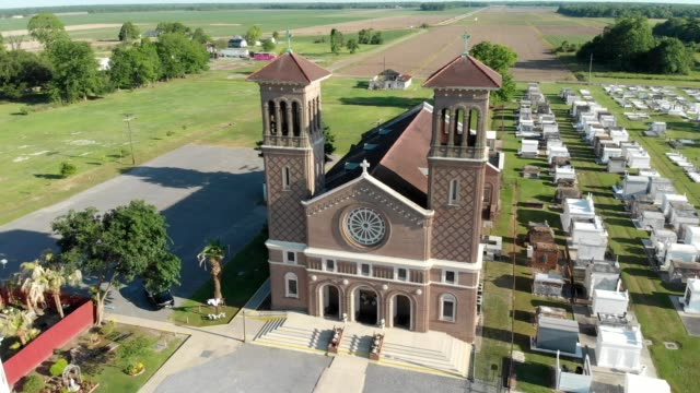 a drone views an antebellum church and grave yard in vacherie louisiana - church stock videos & royalty-free footage