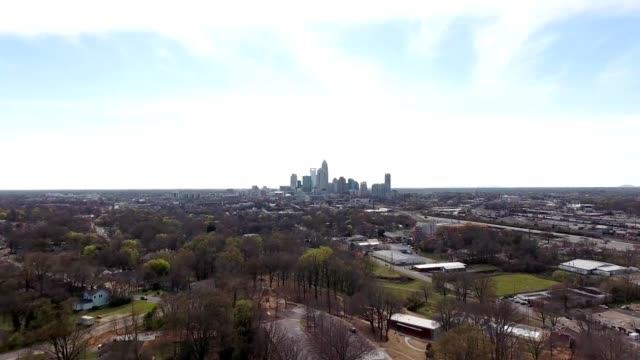 a drone views downtown charlotte north carolina from a distance - charlotte north carolina stock videos & royalty-free footage
