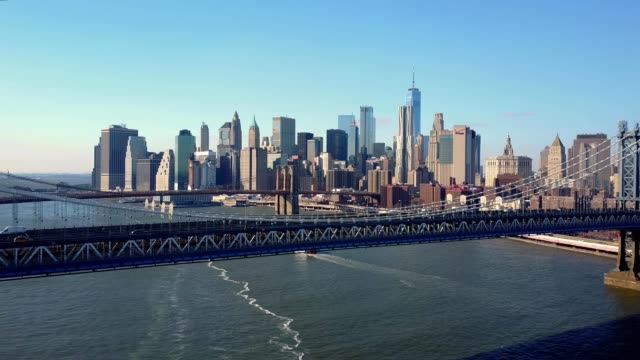 a drone views downtown manhattan from the brooklyn bridge in new york - brooklyn bridge stock videos & royalty-free footage