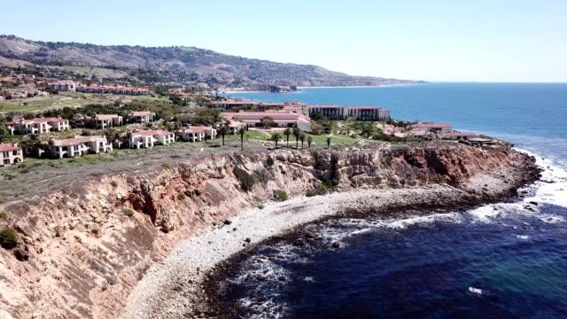 a drone views terranea oceanfront resort in rancho palos verdes california - palos verdes stock videos & royalty-free footage