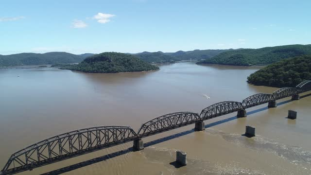 drone vision of railway bridge over river - railway track stock videos & royalty-free footage