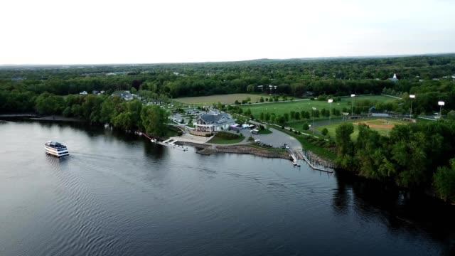 a drone watches a boat house cruise on riverfront park in glastonbury connecticut - connecticut bildbanksvideor och videomaterial från bakom kulisserna