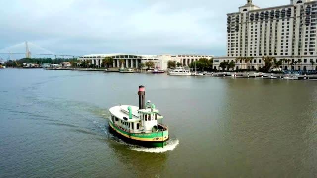a drone watches a ferry on the savannah river in georgia - savannah georgia stock videos & royalty-free footage