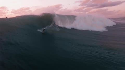 stockvideo's en b-roll-footage met a drone watches surfers in rincon puerto rico - surf