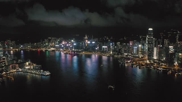 drone wide shot of west kowloon, hong kong - illuminated stock videos & royalty-free footage