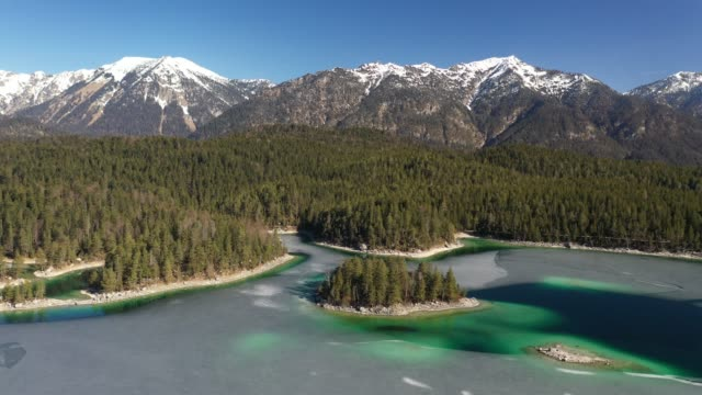 stockvideo's en b-roll-footage met droneflight above lake eibsee in bavaria, germany, europe - bavarian alps