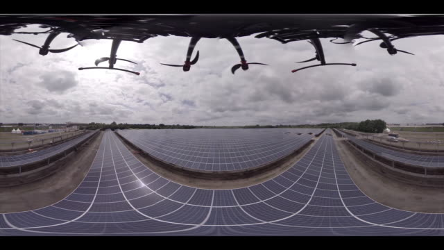 droneflight over solar park - monoscopic image stock videos & royalty-free footage