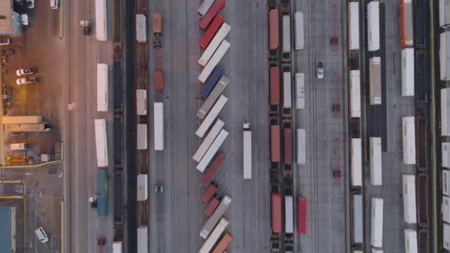 drones: an aerial road trip straight down shipping containers - heavy goods vehicle stock videos & royalty-free footage