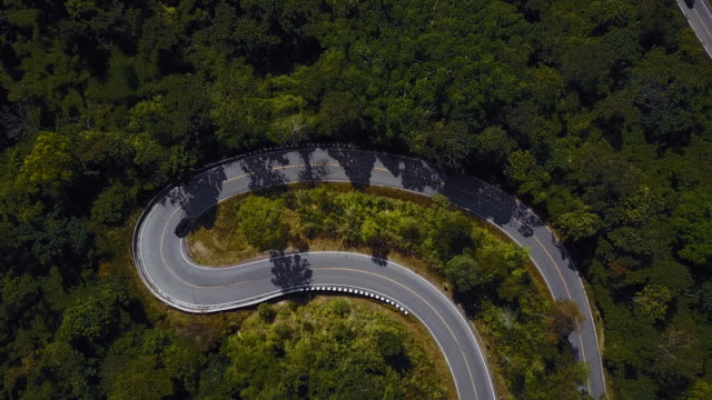 drones: an aerial road trip - curve stock videos & royalty-free footage