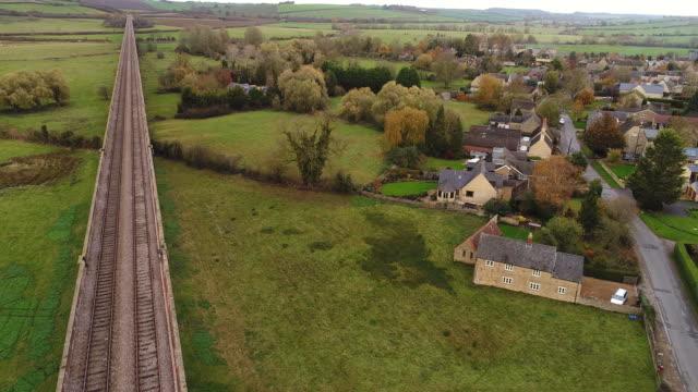 drones eye view along the harringworth railway viaduct. - viaduct stock videos & royalty-free footage