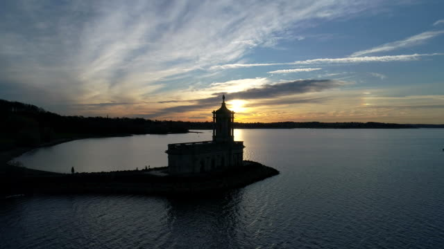 drones eye view of normanton church, rutland water reservoir, - leicestershire stock videos & royalty-free footage