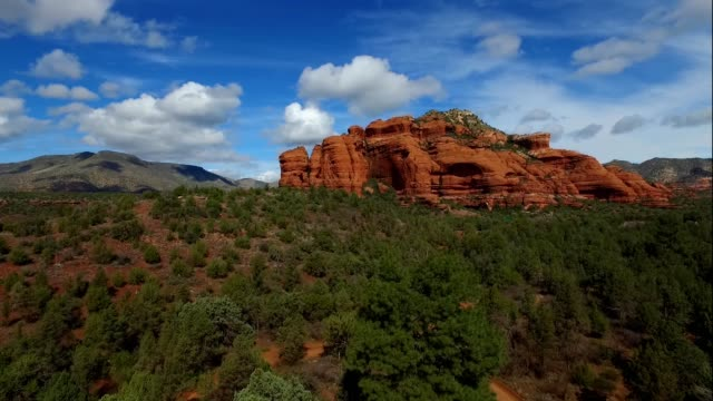 a drones flies through a red rock canyon in sedona arizona - sedona stock videos & royalty-free footage