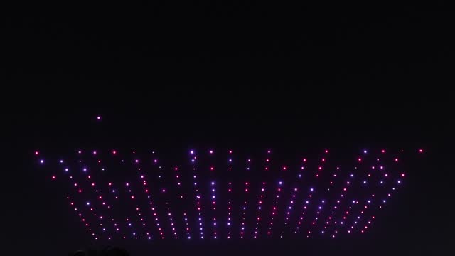 drones fly over the olympic park showing messages to support the country and share measures to contain the spread of the coronavirus on november 13,... - illuminated stock videos & royalty-free footage