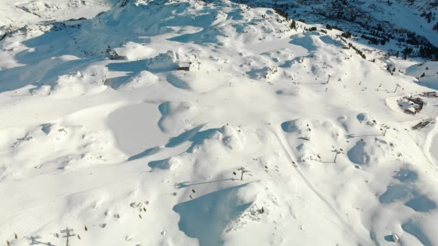 droone shoot of ski slopes in the alps - ski flying stock videos and b-roll footage