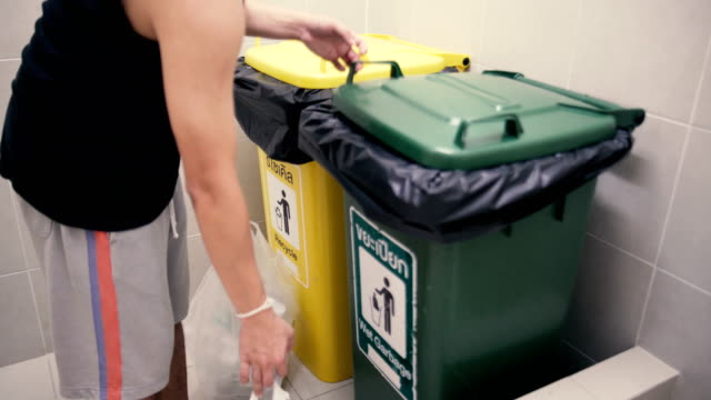 drop garbage in the bin - trash can stock videos and b-roll footage