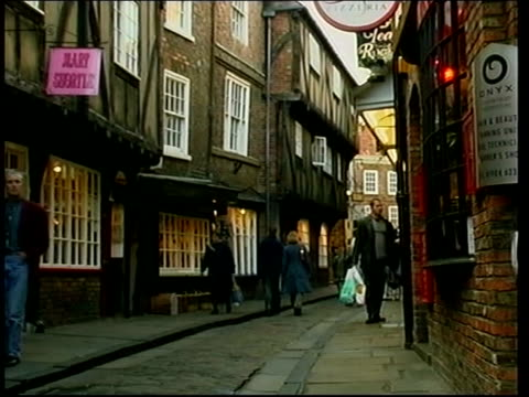 drop in numbers following terrorist attacks lib yorkshire york ext people along narrow lane lined with shops gift shop - war in afghanistan: 2001 present stock-videos und b-roll-filmmaterial