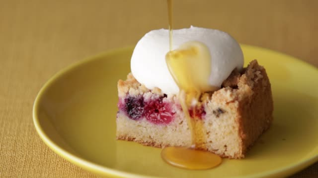 drop maple on crumble cake with fresh cream. - gluten free stock videos & royalty-free footage