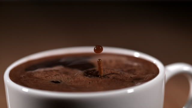 SLO MO Drop of a coffee falling into a cup