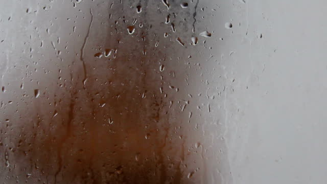 Drop on glass and woman shampoo background