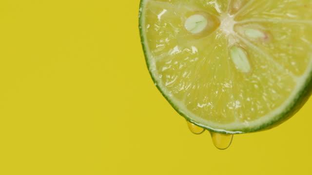 蜂蜜レモン スライスから落ちてくる水滴 - かんきつ類点の映像素材/bロール