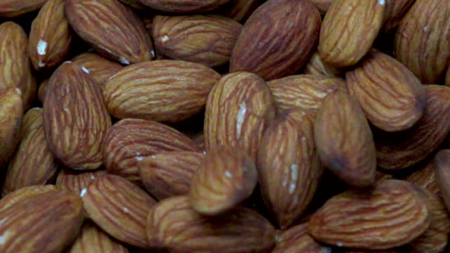 dropping almonds - slow motion - almond stock videos and b-roll footage